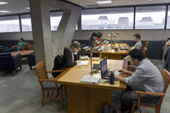 photo of grad students in the library